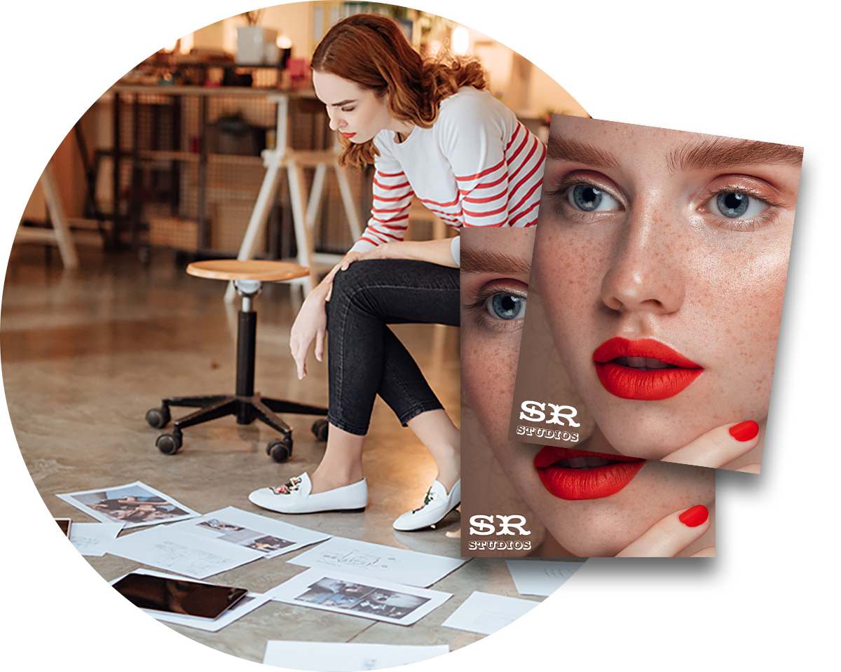 Woman sitting in a marketing and advertising agency reviewing printed work with an overly of two photograph prints.