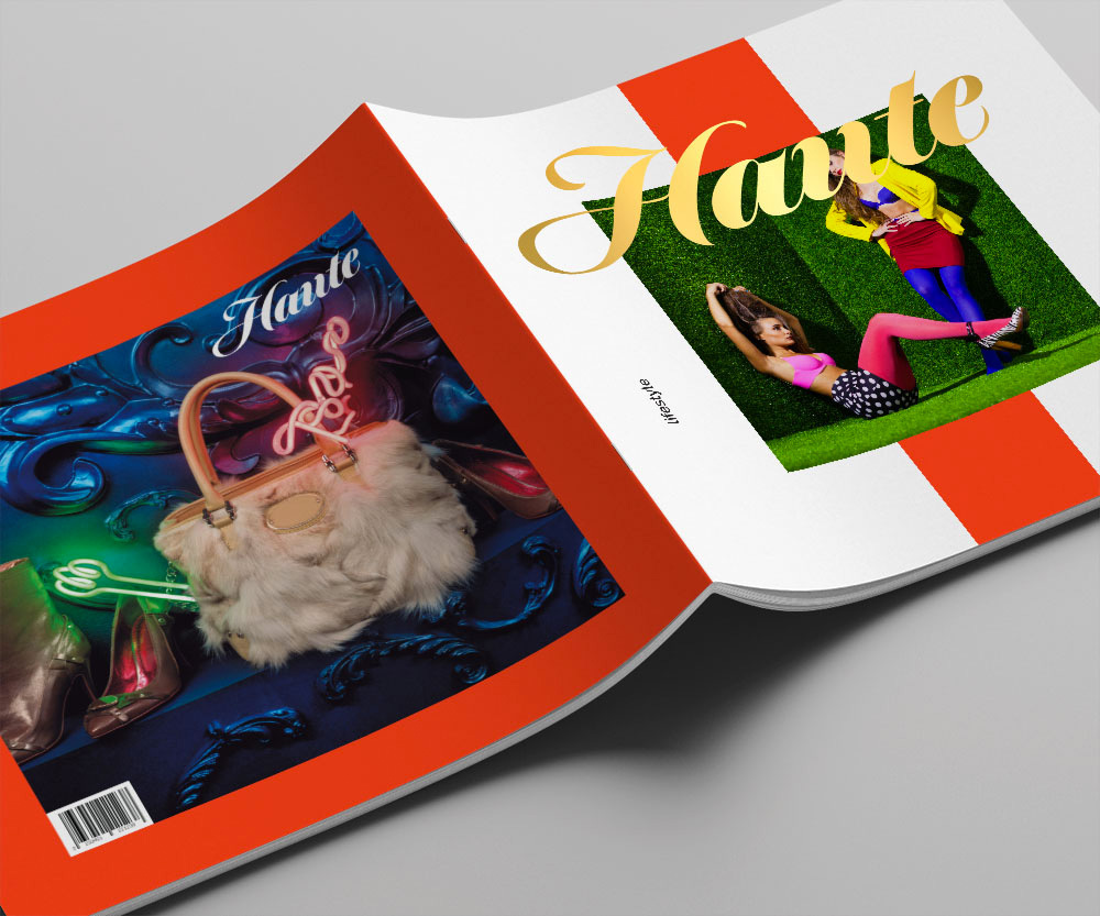 A catalog open and turned upside down for Haute fashion. On the back is a large purse on a bright colorful background. The front has two models with their handbags.