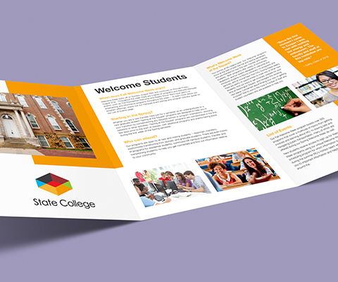 A large, open tri-fold brochure sits on a purple background. The brochure is for state college with numerous images of people around campus and unreadable text.