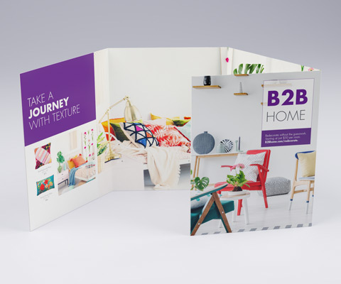 A four-panel brochure standing up on a white background. The brochure depicts a furniture store named B2B Home with brightly colored furniture images.