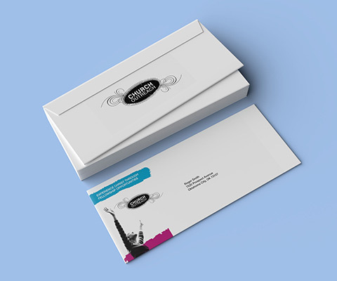 A stack of envelopes on a plain baby blue background with one envelope singled out to show the printing.