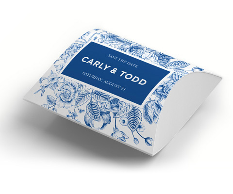Rectangular 3D event package with blue flowery design and a solid block in the center with white text that reads Carly & Todd