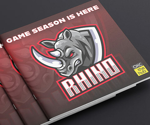 A stack of Rhino game programs. The red and black programs have the image of a mad rhino bursting through.