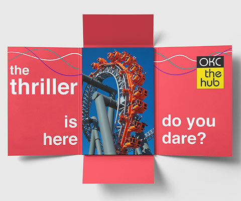 "A four-panel fold out invite with a red inside that reads ""the thriller is here. do you dare?"" and an OKC the hub logo on the right. An image of a rollercoaster ride sits in the center."