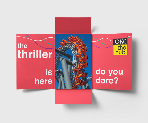 """A four-panel fold out invite with a red inside that reads """"the thriller is here. do you dare?"""" and an OKC the hub logo on the right. An image of a rollercoaster ride sits in the center."""