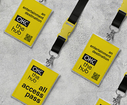 Three yellow all access passes on black lanyards.