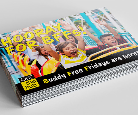 A stack of postcards for OKC The Hub. The image shows kids on a rollercoaster screaming with their hands up. Text overlay says Hooray for BFFs! Buddy Free Fridays are here!