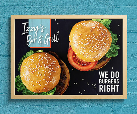 "A wall poster for Izzy's Bar & Grill featuring two hamburgers on a black background. The text reads ""we do burgers right."""