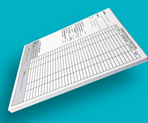A stack of pre-printed finance documents sitting on a teal back drop