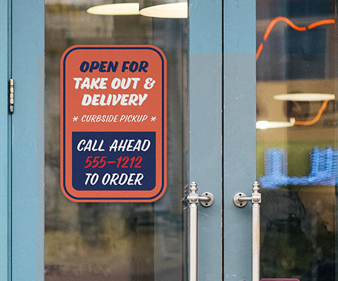 """A red sign on a door that reads """"open for take out & delivery. Curbside pickup. Call ahead 555-1212 to order"""""""
